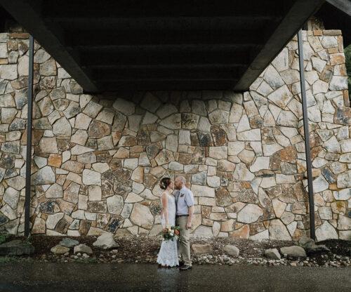 Bride and Groom under wooden bridge