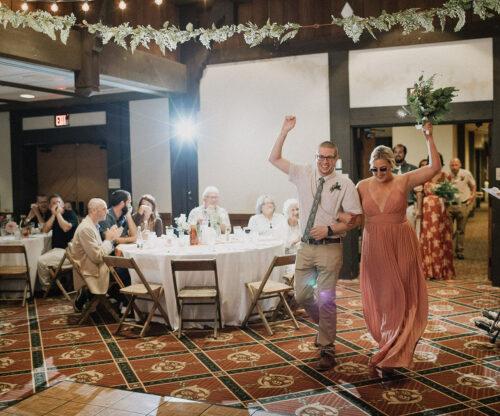 Bridal party walking into wedding reception