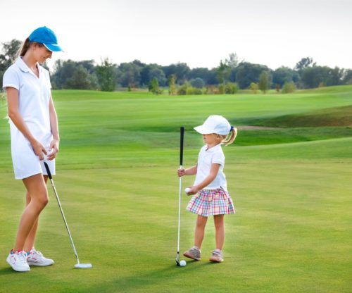 Mom and daughter golfing